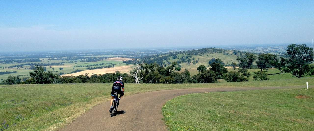 Cycling down TV Access Rd on top of Greater Shepparton's highest point, Mt Major.
