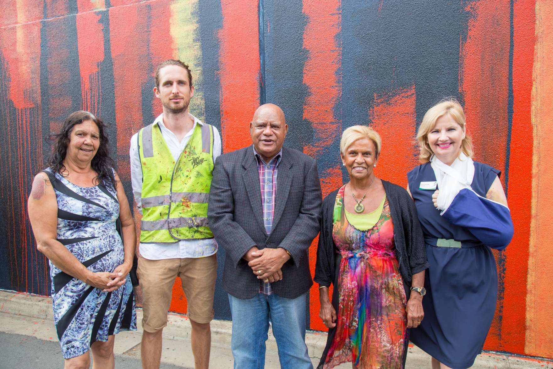(L-R) Merle Miller (Rumbalara Co-op, Elders Committee Member), Adnate (Project artist) Robert Nicholls (Nephew of Sir Douglas Nicholls), Aunty Pam Pedersen (Eldest Daughter of Sir Douglas Nicholls), Cr Kim O'Keeffe (Deputy Mayor, Greater Shepparton City Council) at today's Aboriginal wall art project in Shepparton.