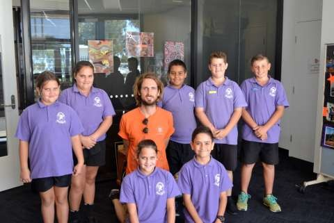Wilmot Road Year 5/6 students who are descendants of Sir Douglas Nicholls, William Cooper, Nora Charles and Margaret Tucker with mural artist, Matt Adnate.